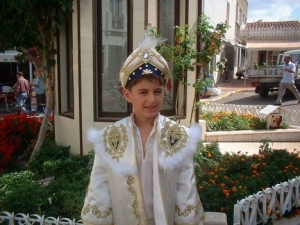 Turkish boy in traditional costume for circumcision