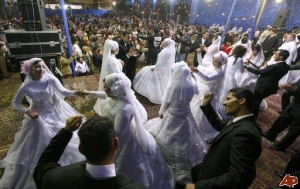 Mass wedding in Egypt with brides and grooms dancing their cares away