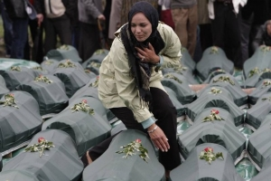 Bosnian woman near the coffin of a loved one killed by Serbians
