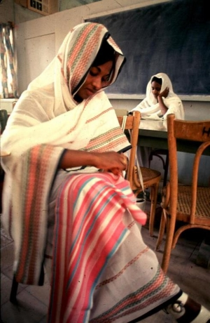 Sudanese woman sewing