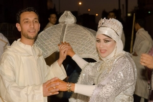 Moroccan newly married couple dancing