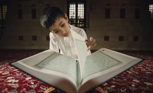 Boy reads the Muslim Holy Book, the Quran, in Riyadh, Saudi Arabia