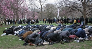 Muslim men praying in the park