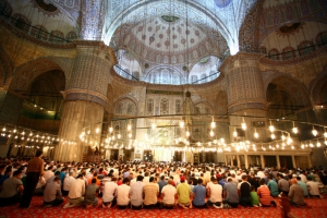 Turkish Muslims at prayer inside the Blue Mosque