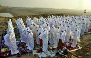 Muslim women praying in a group in Java, Indonesia