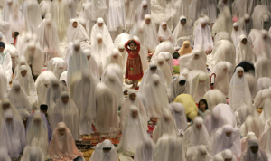 Muslim women at prayer, Indonesia