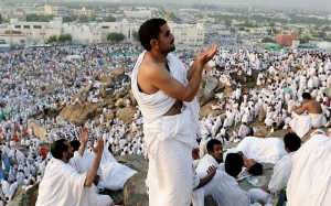 Man prays during the Hajj pilgrimage