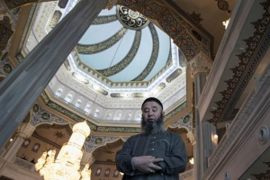 A believer prays inside the newly restored Moscow Cathedral Mosque in Moscow, jpg