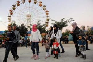 Palestinians celebrate Ramadan at amusement park in the West Bank