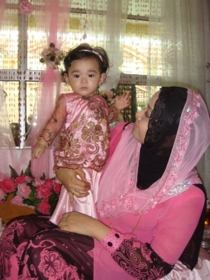 Proud Indonesian mother with newly circumcised  daughter