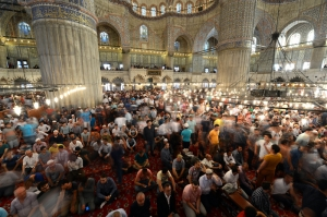 Turkish Muslims inside Blue Mosque in Istanbul during celebrations of Eid al-Fitr.
