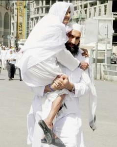 son-carrying-mother-to-juma-prayers-madina